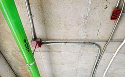 Green water pipes installed on the cement ceiling Stock Images