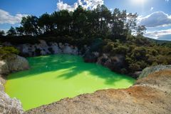 Green water pool in geothermal area very low PH water. Crater and mud hole in this landscape in nature. Blue sky  summer give a beautifull scenery in this royalty free stock images