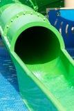 Green water slide. Stock Photos