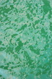 Green water surface. Background, texture or pattern stock photo
