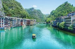 Green water and traditional construction in China. Green water, small boat, traditional construction in a small town of west southern China Stock Photography