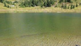 Green water in Upper Tipsoo Lake stock footage