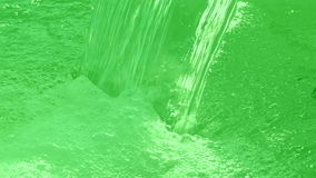 Green water, waterfall closeup, Stock Images