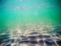Green water and white sand Royalty Free Stock Photography