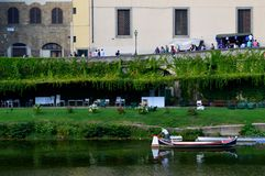 Green waterfront in Florence, Italy stock photography