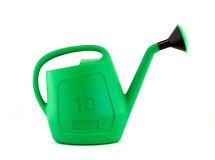 Green watering can. 10L bright green watering can profile stock photo