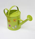 Green watering can. Isolated funny coloured watering can Royalty Free Stock Image