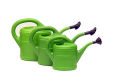 Green watering cans on white Royalty Free Stock Photos