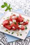 Green watermelon feta salad. Greek watermelon feta cheese salad with mint and pine nut on a square plate Royalty Free Stock Photos