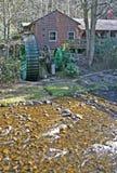 Green Waterwheel & Creek Stock Image