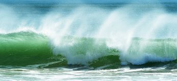 Green wave. With water spray stock photo