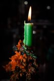 Green wax candle. On dark background Royalty Free Stock Photography