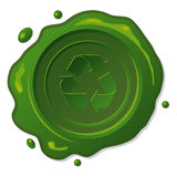 Green wax seal with recycle symbol Royalty Free Stock Photo