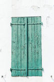 Green Weather Worn Wooden Shutters Stock Photography