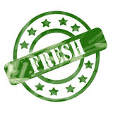 Green Weathered Fresh Stamp Circles and Stars. A green ink weathered roughed up circles and stars stamp design with the word FRESH on it making a great concept Royalty Free Stock Photos