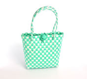 Green weave bag on white background stock image