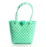Green weave bag on white background stock photography
