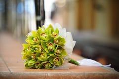 Green wedding bouquet. Lies on a clay tile Stock Photo