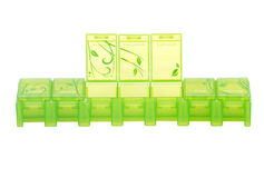 Green weekly pill organizer Stock Images