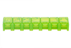Green weekly pill organizer Royalty Free Stock Images