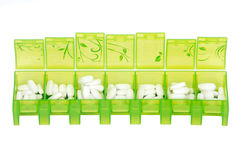 Green weekly pill organizer Stock Photography