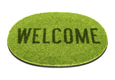 Green welcome mat Stock Photography