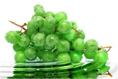 Green and wet. Wet green grapes in water Stock Photos