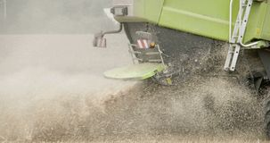 A green wheat harvester truck on the field Stock Photography