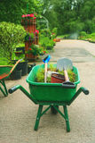 Green wheelbarrow Stock Images