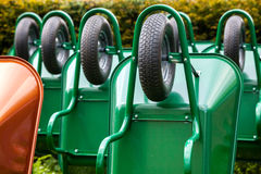 Green wheelbarrows. For gardening or building work Stock Photos