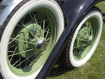 Green Wheels. Close up of wire-wheels painted green, with white-wall tyres Royalty Free Stock Photo