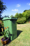 Green Wheely Bin. Environment friendly green wheely bin for garden rubbish Stock Photos