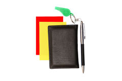 Green whistle. Green plastic whistle and red card on white background Royalty Free Stock Photo