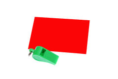 Green whistle. Green plastic whistle and red card on white background Royalty Free Stock Photos