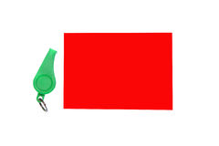 Green whistle. Green plastic whistle and red card on white background Royalty Free Stock Images