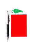 Green whistle. Green plastic whistle and red card on white background Stock Image