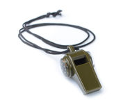 The green whistle on a white Royalty Free Stock Photography