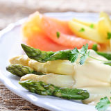 Green and white aspagarus. Green and white asparagus with potatoes and smoked salmon Royalty Free Stock Image