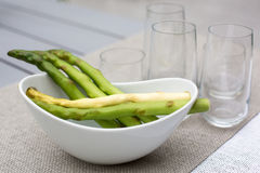 Green and white asparagus in bowl Stock Photo