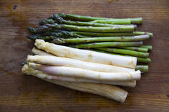 Green and white asparagus on kitchen board Royalty Free Stock Photo