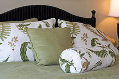 Green & white bedding, pillows Royalty Free Stock Image
