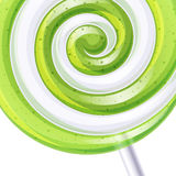Green and white big lollipop spiral candy Royalty Free Stock Image