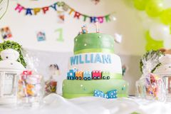 Green and White Birthday Cake with One Year Old Candle with Happ royalty free stock photo