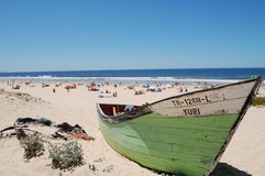 Green and White Boat in a Sandy Beach Stock Image