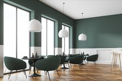 Green and white cafe corner. With a wooden floor, round black tables and green chairs. A poster. 3d rendering mock up Royalty Free Stock Photography