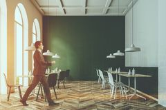 Green and white cafe interior toned Stock Photography