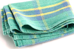 Green white checkered dishcloth, wiper isolated on white backgro. Und Stock Photos