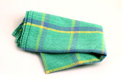 Green white checkered dishcloth, wiper  on white backgro Stock Photography