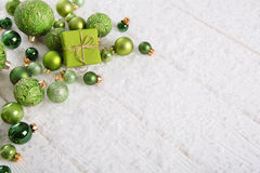 Green and white christmas background with gift box, snow and bal Stock Image