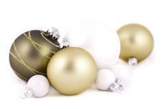 Green and white christmas decorations. Green and white christmas balls or decorations, on  a white background, with shallow depth of field Stock Image